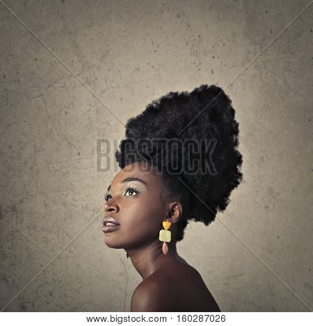 Portrait of a black girl with big black hair