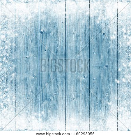 Light blue board with snow and frost. Winter Wooden background. Christmas. celebration. Cold. Snowfall. Frost. New Year. Card.