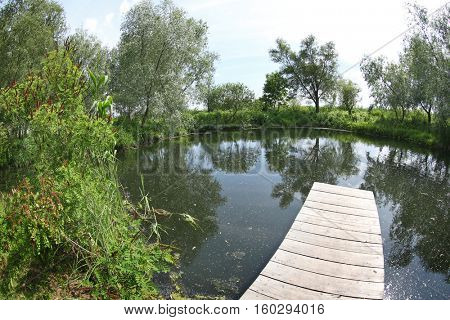 Beautiful landscape with wooden pier