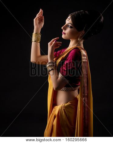 Young indian woman on black