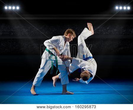 Boys martial arts fighters in sports hall