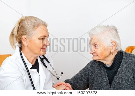 Picture of an old lady with her caregiver