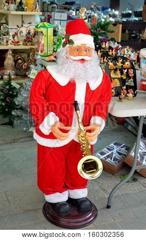 BEER SHEVA ISRAEL - DECEMBER 05 2016: Figure of Santa Claus with a sax at the entrance to the store