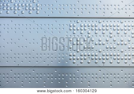 Rigid steel surface as background texture closeup