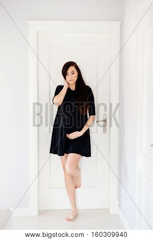 Beautiful Young Pregnant Woman In Black Dress