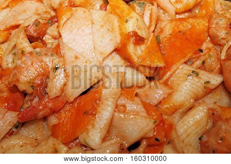 fish sauces with tomato, shrimp, crab meat, shrimp in the pan