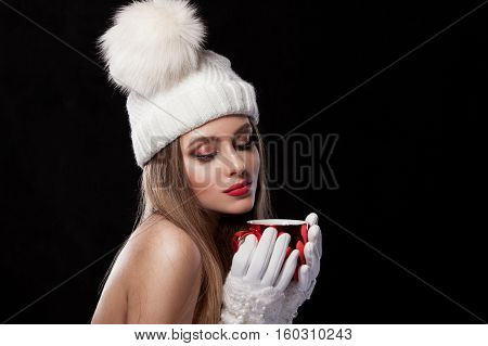 Beautiful Girl In A White Cap And Gauntlets, Holding A Red Mug
