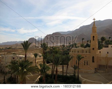 photo of landscape with ancient architecture of the Coptic monastery of St. Anthony in Egypt amid the beautiful mountains of the Eastern desert