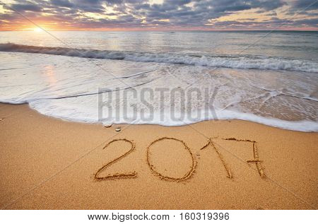 2017 year on the sea sand shore. Element of design.