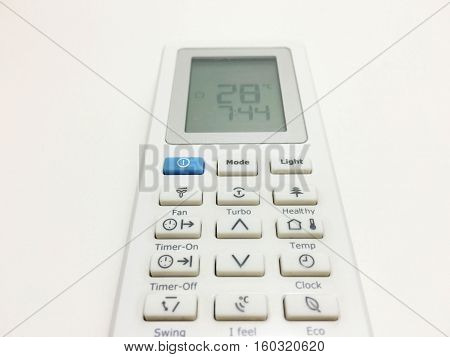 Remote control of air conditioning is made from white plastic on a white background.