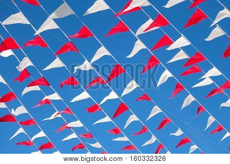 Small bunting hanging over blue sky background