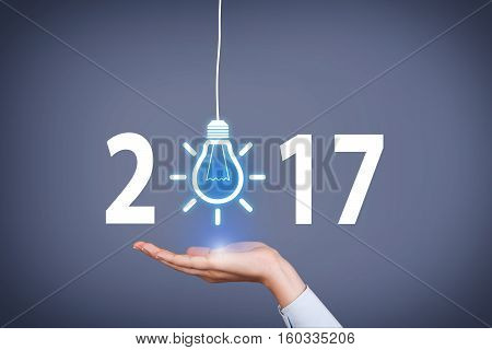 Human Hand Touching New Year 2017 Idea Concepts on Screen