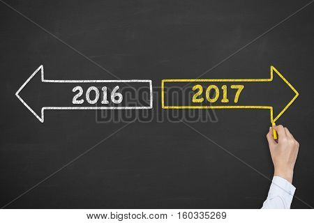 Old Year or New Year on Chalkboard Background