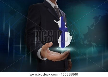 Businessman showing map of Finland on globe background