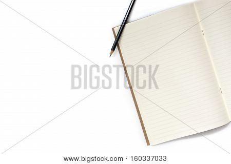 Top view of open notebook and pencil with copy space background