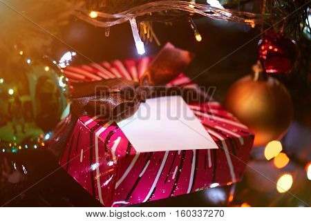 Christmas toys on tree with decorations and gift box