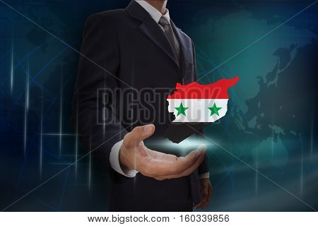 Businessman showing map of Syria on globe background