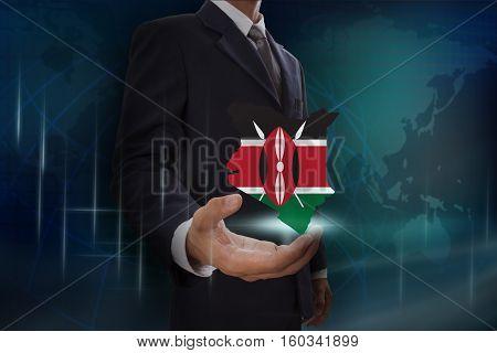 Businessman showing map of Kenya on globe background