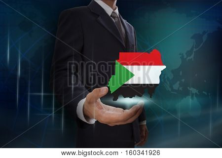 Businessman showing map of Sudan on globe background