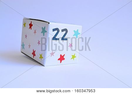 white cardboard box with stars and number 22 twenty two on it