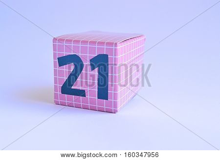 pink cardboard box with twenty one 21 printed on it in blue