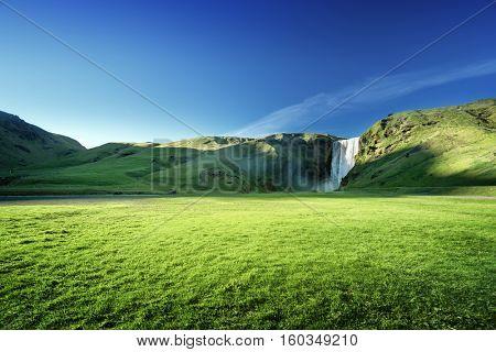 Skogarfoss waterfall and summer sunny day, Iceland
