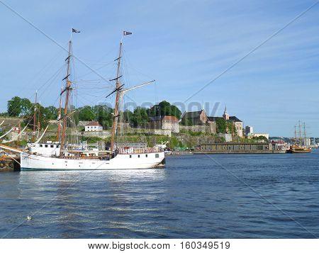 White sailing ship against Akershus Fortress, Olso Harbor, Norway
