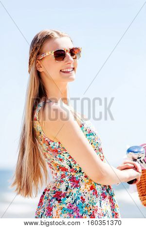Portrait of a pretty woman with bicycle