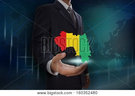 Businessman showing map of Guinea on globe background