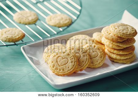 Biscuits stamped with 'made with love', on plate