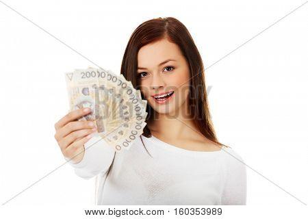 Happy young lady holding cash-polish zloty