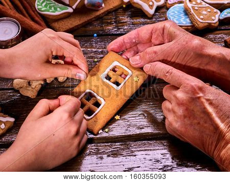 The family made a gingerbread house for Christmas. Christmas with his family at home.