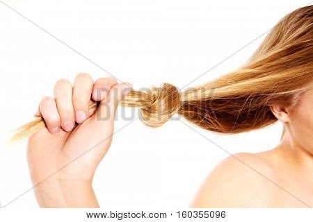 Blonde hair knot isolated on white background.