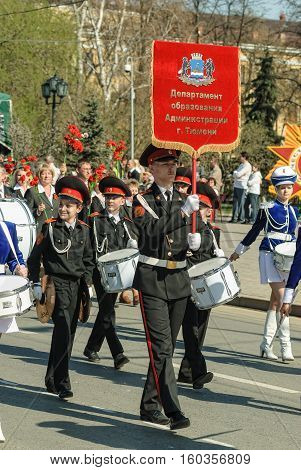 Tyumen, Russia - May 9. 2009: Parade of Victory Day in Tyumen. Cadet military orchestra plays and walks on Victory Day parade