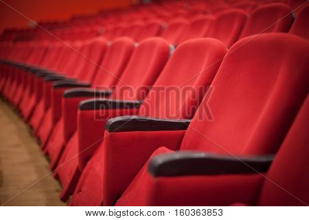 empty red cinema or theater seats in a row