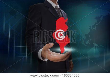Businessman showing map of Tunisia on globe background