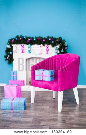 Christmas gifts and a beautiful chair in front of the fireplace
