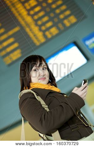 Beautiful Young Girl Sending Sms In Airport