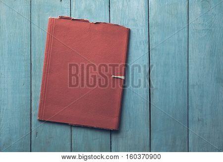 retro folder on old blue wooden background