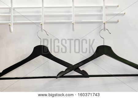 The image of hangers in a cloakroom