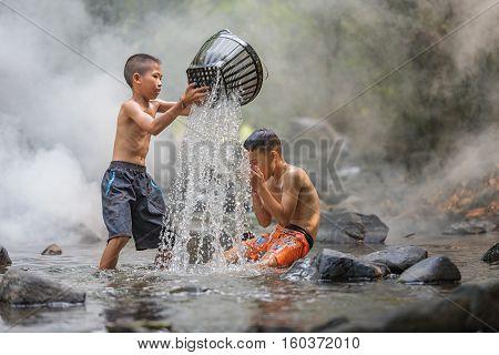 Children fishing in the riverChildren playing .