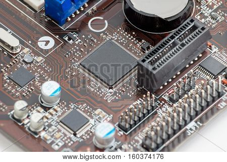 Fragment of printed circuit assembly with electronic components closeup