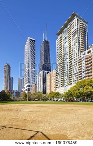 Chicago City Downtown Buildings Seen From A Playing Field.