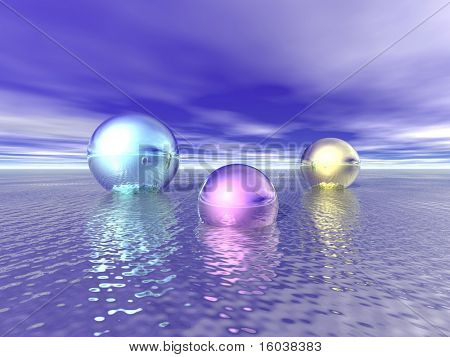 Shiny metallic Spheres float on a calm sea