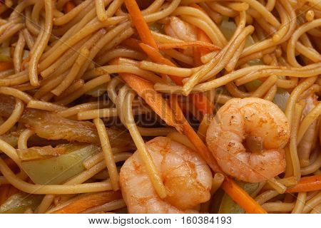 Chinese dish. Chinese food. Spaghetti with shrimps. Closeup.