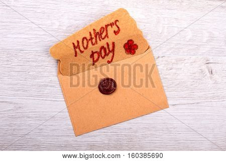 Mother's Day greeting letter. Card and envelope with seal. Creative congratulation for mommy. Wax stamp as decorative element.