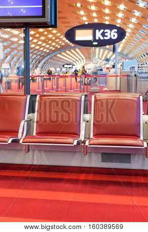 empty red seat in departure area of airport