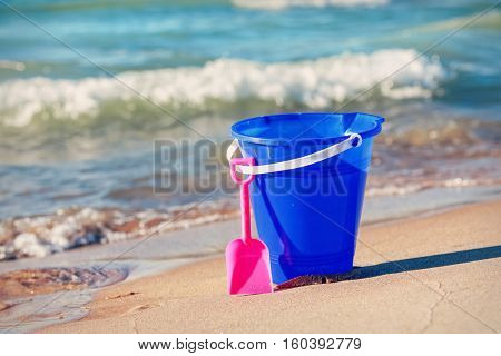Child's sand pail and bucket at the beach