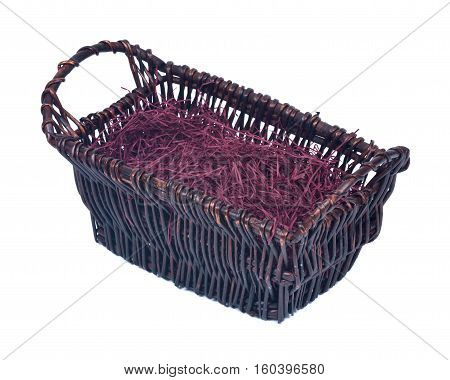 Empty wicker basket for gifts with shredded paper isolated on white background
