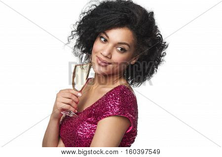 Party, drinks, holidays and celebration concept. Closeup of pensive woman in sequined dress with glass of champagne looking to the side at blank copy space
